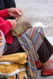 Elderly man makes baskets for use in the fishing industry in the traditional way, in Gallipoli, Puglia, Italy. Gallipoli, Italy. Elderly man makes baskets for royalty free stock photo