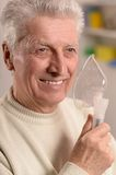 Elderly man making inhalation Royalty Free Stock Photo
