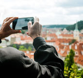 Elderly man is making pictures of city views Stock Photography