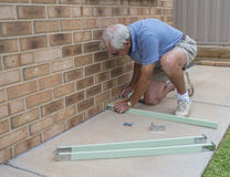 Elderly Man Making Wooden Frame. Stock Photography