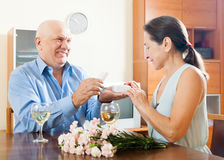 Elderly man with mature woman having romantic date Stock Image