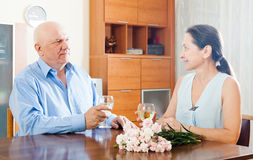 Elderly man with mature woman having wine Royalty Free Stock Images