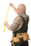 Elderly man measuring Royalty Free Stock Photo