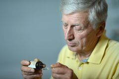 Elderly man with medicines Stock Photo