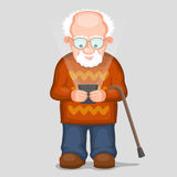 Elderly man and modern phone Royalty Free Stock Photography