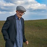 Elderly man in mountains stock photography