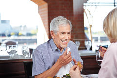 Elderly man with napkin at Stock Photo