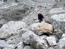 An elderly man near the edge of Fox glacier Stock Photography