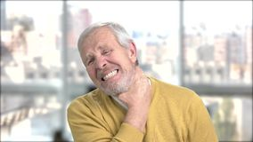 Elderly man with neck and shoulder pain. Portrait of man with neck ache. Nerve injury concept stock video