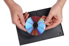 An elderly man with nostalgia looks at an old DVD on which family events are recorded. Isolated. On white studio closeup shot stock photo