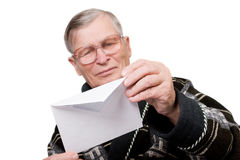 Elderly man opening letter envelope Royalty Free Stock Images