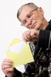 Elderly man opening letter envelope Stock Photos