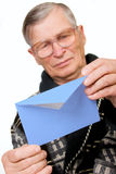Elderly man opening letter envelope Royalty Free Stock Photos