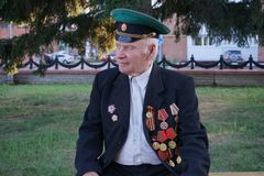 Elderly man with orders and medals. Tara, Omsk region, Russia, July 30, 2018. A veteran of the Great Patriotic War stock images