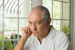 Elderly man ost in thought Stock Photo