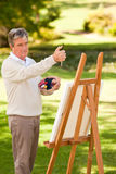 Elderly man painting Royalty Free Stock Photos