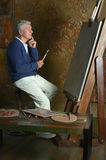 Elderly man painting Stock Photography