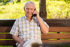 Elderly man on the phone. Royalty Free Stock Photography