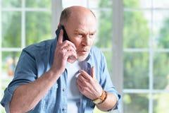 Elderly man with phone Stock Photos