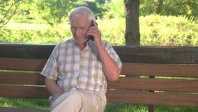 Elderly man with phone. stock video