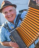 Elderly Man Playing the Accordion