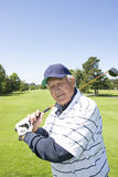Elderly man Playing Golf Royalty Free Stock Image
