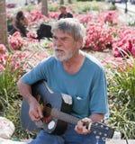 Elderly man playing guitar Royalty Free Stock Photo