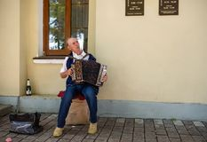 An elderly man playing the russian accordion. Suzdal, Russia Stock Image