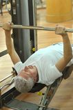 Elderly man playing sports in a gym Royalty Free Stock Photo