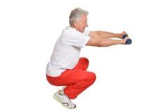 Elderly man playing sports Stock Image