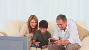 Elderly man playing video games stock video footage
