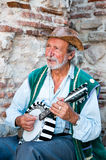 An elderly man plays musical instrument banjo Aug Stock Photos