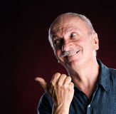 Elderly man pointing Royalty Free Stock Images