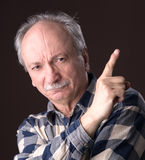 Elderly man pointing up Royalty Free Stock Image