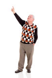 Elderly man pointing up Stock Photo