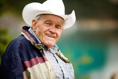Elderly Man Portrait. A portrait of a happy elderly man with cowboy hat royalty free stock photography