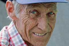 Elderly man. Portrait close up of the smiling elderly man Royalty Free Stock Photography