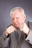 Elderly man in a pose of boxer Royalty Free Stock Image
