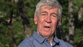 Elderly Man Posing Outdoors stock video