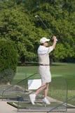 Elderly Man Practicing Golf. An Elderly Man Practicing His Golf Swing Stock Image