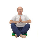 Elderly man practicing yoga or fitness. Royalty Free Stock Photos