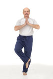 Elderly man practicing yoga or fitness. Royalty Free Stock Images