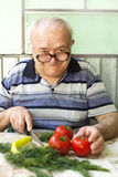 Elderly man preparing healthy food. Vegetarian diet Royalty Free Stock Photo