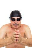 Elderly man preparing to dive into pool Royalty Free Stock Image