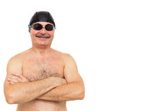 Elderly man is preparing to swim. On his head wearing a special royalty free stock image