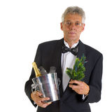 Elderly man with presents. Elderly man with christmas tree and champagne Stock Photos