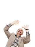 Elderly man is protected from something falling on his head expo Stock Photo
