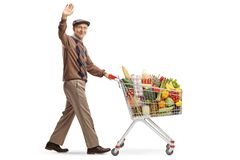 Elderly man pushing a shopping cart and waving. Full length shot of an elderly man pushing a shopping cart and waving isolated on white background royalty free stock images