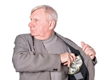 Elderly man puts money Royalty Free Stock Photos