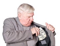 Elderly man puts money in an pocket Royalty Free Stock Images